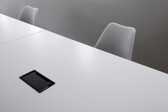 Close up of high quality office desks and chairs, special composition background