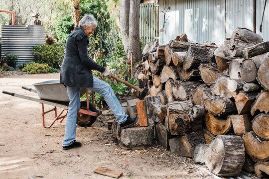 Woman splitting firewood