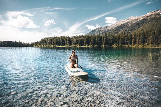 woman in clear mountain lake