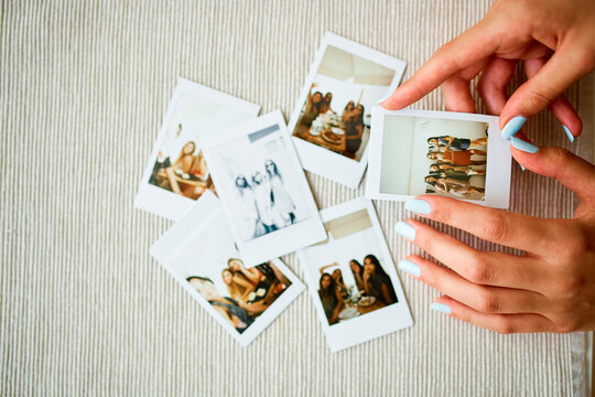 Girl looking at instant photos