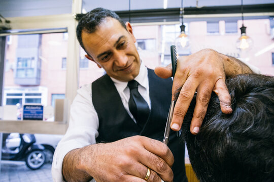 Smiling man styling customer