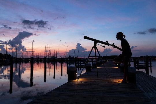 Landscape Portrait of Young Astronomist with Telescope
