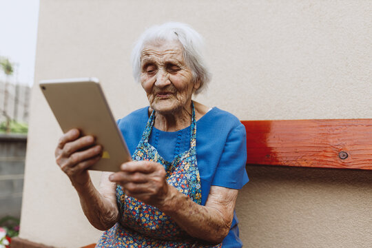 Granny having online meeting with children