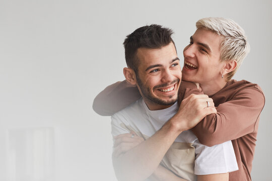Portrait of Carefree Gay Couple Indoors