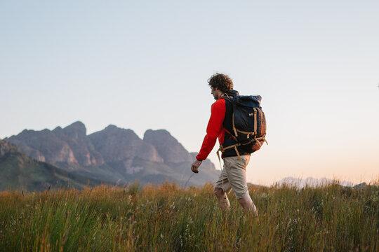 Young Man Hiking at sunset