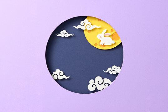 Rabbit celebrating mid-autumn festival in paper cut style