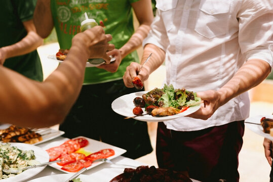 All you can eat BBQ buffet with people choosing their food