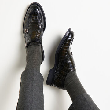Man in stylish handmade leather shoes on a light background