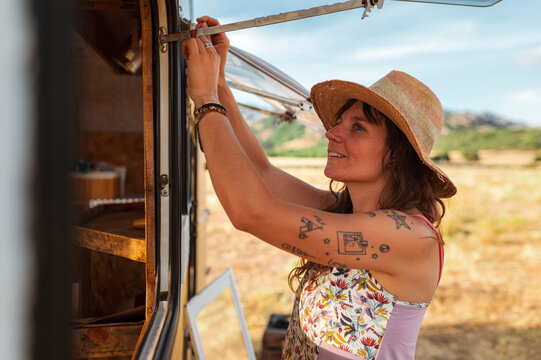 Entrepreneur women travelling in upcycling clothes caravan