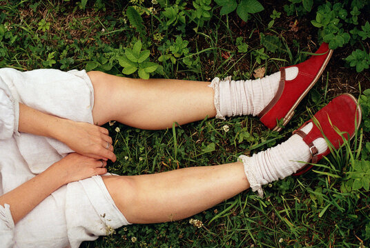 Female legs on the grass