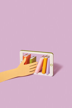 Papercraft hand chooses books in a smartphone.