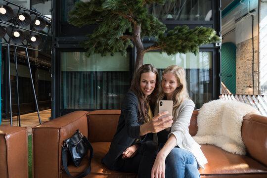 Two Women Taking Selfie Indoors
