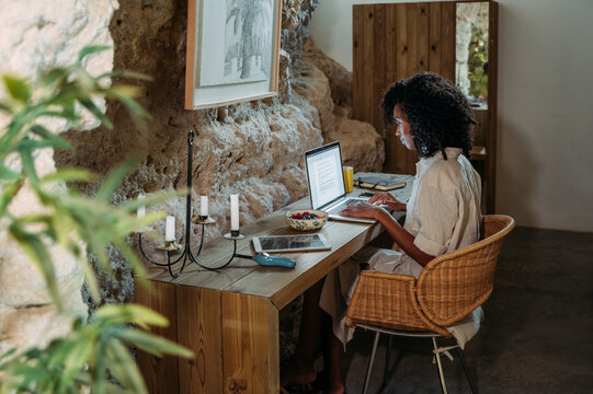 Modern businesswoman working with laptop at home