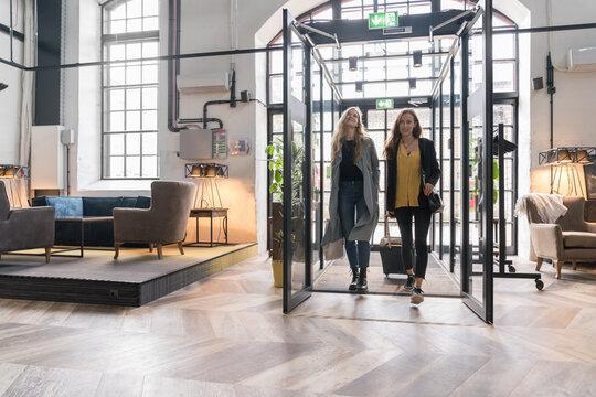 Two Women Entering In A Hotel