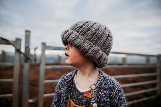 boy looking left with beanie on