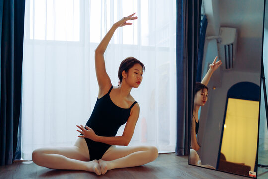 Young woman dance at home