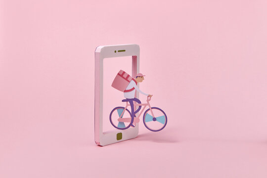 Handmade courier on a bicycle riding through smartphone.