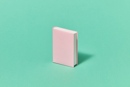 One mockup pink craft book made from paper.
