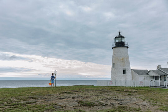 Young Child with Fishing Net at Maine Lighthouse