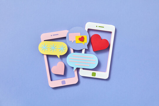 Two papercraft smartphones and chats cloud icons.