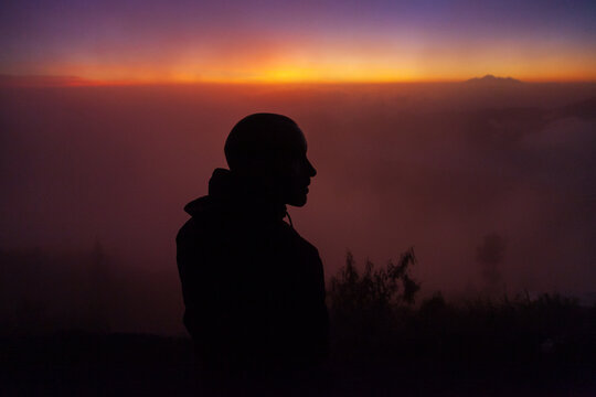Silhouette of a man on the mountain at sunrise