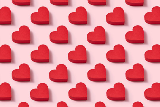 Papercraft red hearts pattern with shadows.
