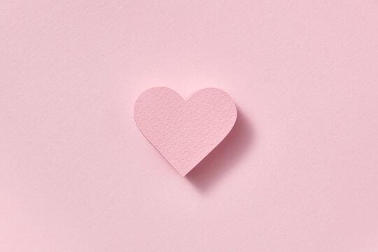 Alone papercraft figure of pink heart.