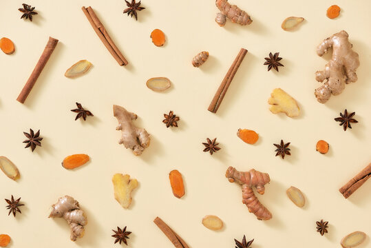 Beautiful Display of Spices: ginger and turmeric root, cinnamon stick, anise star on a color background
