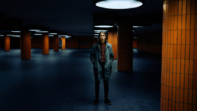 Portrait of a young man with long hair in the underground