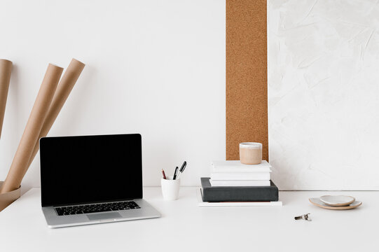 Laptop and stationery on table