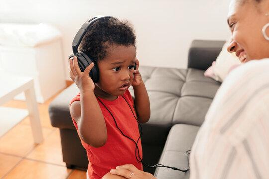 Little kid listening to music