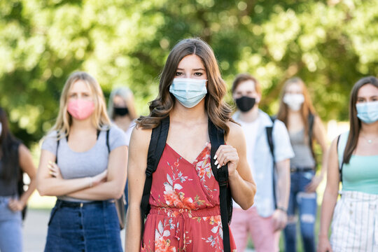 Covid: Group Of Students With Face Masks Looking At Camera