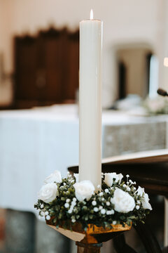 large white wedding candle in church