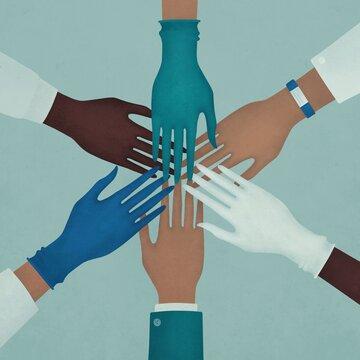 Doctors and nurses coordinate stacking hands together at hospital. Concept Teamwork.