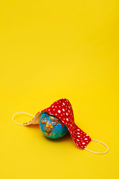 face mask on a world globe