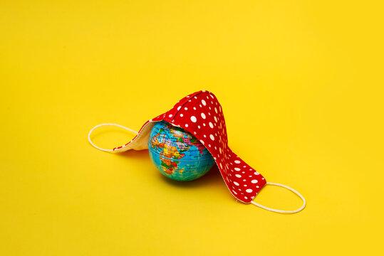 face mask and world globe