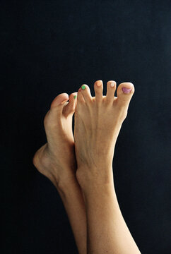 Female feet with colorful nail polish