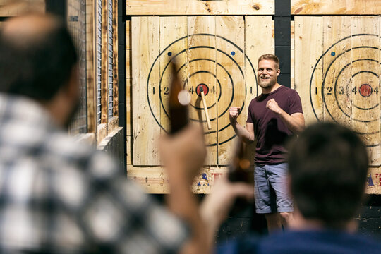 Man Excited After Hitting Bullseye