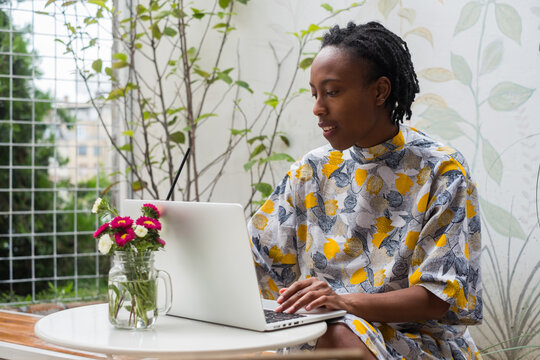 Young Black Woman Working On The Laptop Outdoors