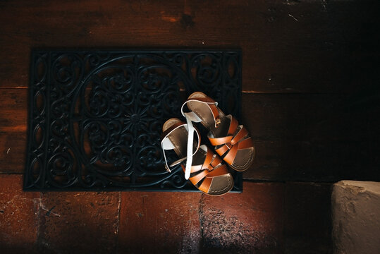 brown leather sandals on the floor