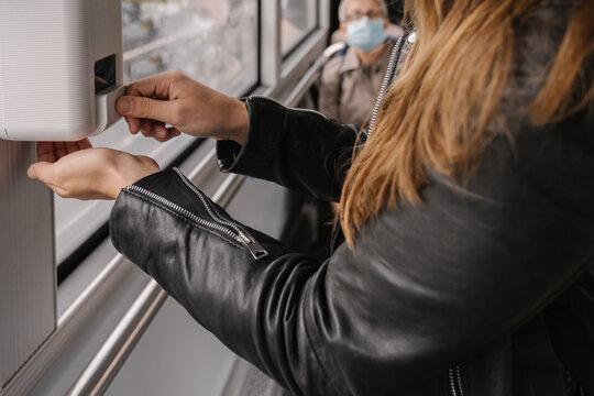 Hand Sanitizer Dispenser In Public Transport