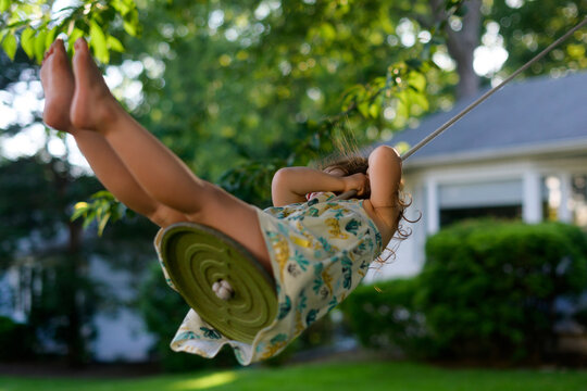 Carefree child on swing in summer