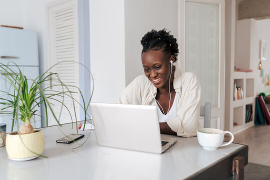 Young woman at her home office
