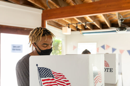 African American Male in Foreground, Voting in American Election