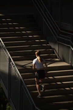 Anonymous blonde woman running