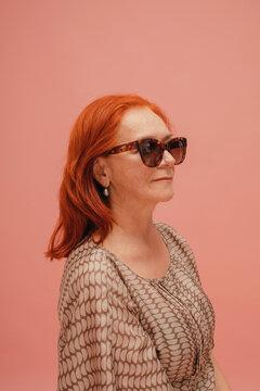 Redhead mature model in sunglasses