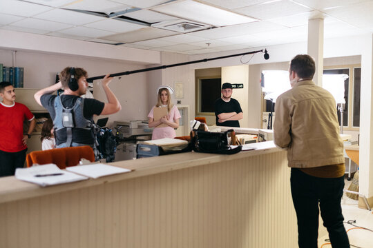 Actors perform their scene at a hospital nurses station