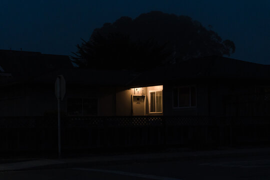house at dusk with one light on