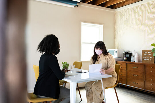 Masked Female Entrepreneurs in an Office Space