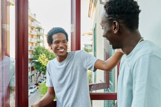 Friends talking on a balcony